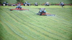 Tractor during work on green lawn Stock Footage
