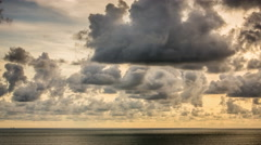 Time Lapse. Sunset clouds over sea - stock footage