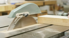 4K Close up of timber being cut with a circular saw - stock footage