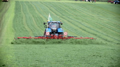 Tractor is reversing grass with brand new equipment Stock Footage