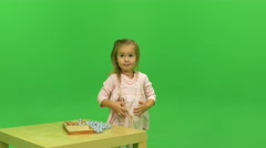 Little girl in a pink dress and with bows on her hair Stock Footage
