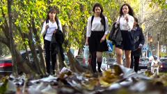 Schoolgirls go after school Stock Footage