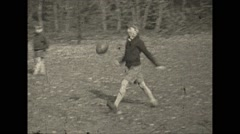 Vintage 16mm film, Philadelphia 1932, boys playing football - stock footage