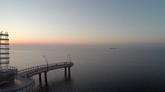 Drone maneuvering to the left while capturing the Sunrise at the Burlington Pier Stock Footage