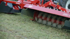 Working with machinery on big green lawn Stock Footage
