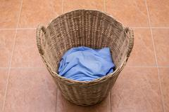 Washing clothes in the laundry basket - stock photo