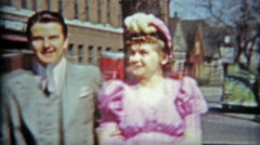 1942: Dapper gentleman attending the big wedding with his date. Stock Footage