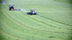 Tractors cutting off the grass Stock Footage