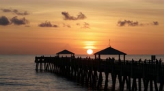 Juno Beach Pier at Sunrise with People Fishing Early Morning Stock Footage