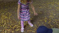 Kids Play Together Outside, Make A Leaf Pile On A Warm Autumn Day (4K) - stock footage