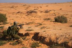 Israeli soldiers excersice in a desert - stock photo