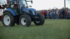 Tractor on work during agricultural fair Stock Footage