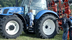 Brand new tractor on agricultural fair - stock footage