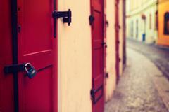 Red wooden door with lock Stock Photos
