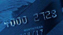 Plastic credit cards to withdraw money from a bank account - stock footage