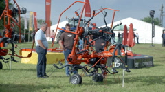 Brand new grass reverser on agricultural fair - stock footage