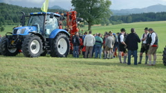 People is looking a tractor on agricultural fair - stock footage