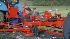 Tractor reverser is on agricultural fair Stock Footage