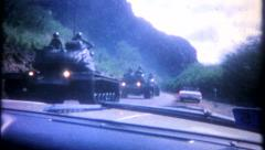 2557 - US military tanks force cars to side of road - vintage film home movie Stock Footage