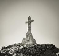 Cross on a rock hill, Tinos, Greece. - stock photo