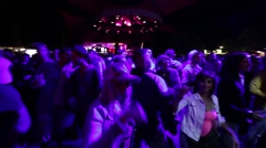 girl dancing in the crowd - stock footage