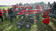 Stock Video Footage of Brand new machinery is positioned at a glance on agricultural fair