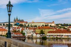 View of colorful old town and Prague castle with river Vltava, Czech Republic - stock photo