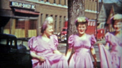 1942: Bridesmaid pink dresses getting ready for support the bride. - stock footage