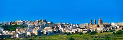 Panorama view of Mgarr city with green field. Gozo, Malta - stock photo