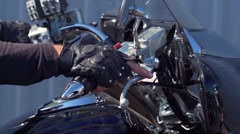 Motorcycle biker gets under way slow motion Stock Footage