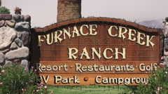 Furnace Creek and twenty mule team sign and wagon Stock Footage