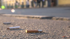 Cigarette butts on the pavement Stock Footage