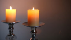 Yellow candles in candlestick Stock Footage