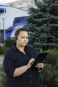 The Business woman in park. - stock photo