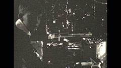 Vintage 16mm film, 1932, Philadelphia, xmas boy playing toy train Stock Footage