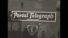 Vintage 16mm film, Philadelphia 1932, postal telegraph store Stock Footage