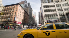 Yellow cabs driving up 6th Avenue in Midtown Manhattan NYC Stock Footage