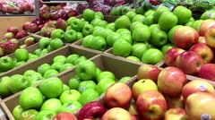 Woman selecting green apple in grocery store Stock Footage