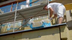 Men is renovating building Stock Footage