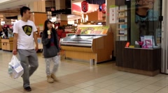 Customer buying foods at T&T Supermarket Stock Footage