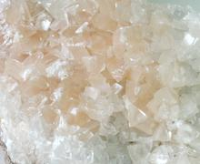 Close up calcite crystal isolated, mineral Stock Photos