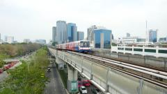 BTS train approaching and pass by, elevated railway Stock Footage
