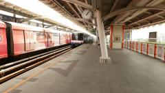 BTS Skytrain arrive to empty Mo Chit station platform - stock footage