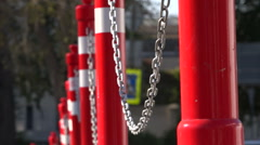 The red pillars connected by a chain. Parking. Stock Footage