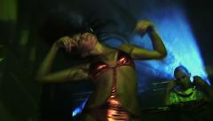 Go go dancer on the stage in brilliant red underwear. DJ plays - stock footage