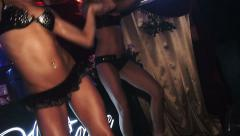 Two girls on the stage. Black corset, skirt and panties. Sexual dancing Stock Footage