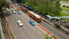 Stock Video Footage of Taxi car queue, bus stop, sparse road traffic, people on sideway, overpass exit