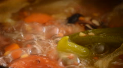 Soup of lentils boiling in a pot - stock footage