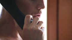 Woman talking at telephone Stock Footage