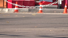 Traffic cones. A strong wind blows away the leaves. - stock footage